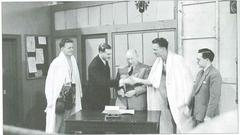 The Cooper twins, Henry and George, Bellingham's favourite sons, signing professional contracts with Jim Wicks in July 1954. Sports commentators Peter Dimmock and Harry Carpenter acted as witnesses